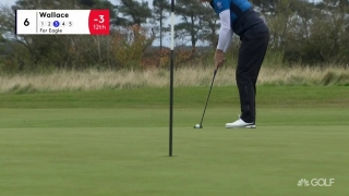 Wait for it... Wallace drains long eagle putt at No. 6